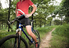 Cyclist stop in the woods Stock Photos
