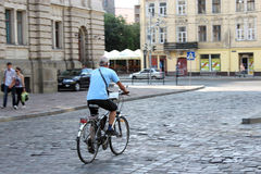 Cyclist in the street of Lvov Stock Image