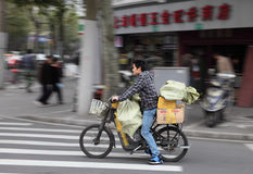 Cyclist in the street of Shanghai Stock Images