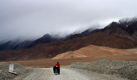 Cyclist among stunning Tibeten landscape Stock Photos