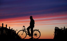 Cyclist At Sunset Stock Images