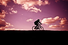 Cyclist at sunset Stock Photography