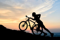 Cyclist in the sunset Stock Images