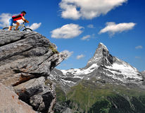 Cyclist in the Swiss Alps. In background Matterhorn Royalty Free Stock Image