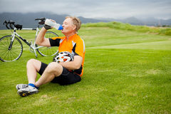 Cyclist taking a break Stock Image