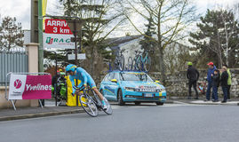 The Cyclist Tanel Kangert - Paris-Nice 2016. Conflans-Sainte-Honorine,France-March 6,2016: The Estonian cyclist Tanel Kangert of Astana Team riding during the Royalty Free Stock Photo