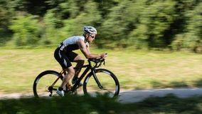 Cyclist in time trial in blurred motion Stock Photography