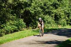 A Cyclist on the Tinker Creek Greenway. Roanoke County, VA – August 19th: A Cyclist enjoy a ride on the Tinker Creek Greenway located in Roanoke County Royalty Free Stock Photography
