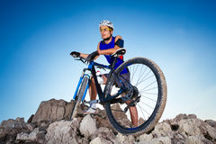 Cyclist on the top of a hill Royalty Free Stock Image