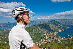 Cyclist on the top of a hill Royalty Free Stock Images