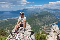 Cyclist on the top of a hill Stock Images