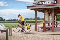 Cyclist touring Katy Trail in Missouri. MARHTSVILLE, MO, USA - AUGUST 1, 2015: A touring cyclist at Marthasville stop on Katy Trail (237 mile bike trail Stock Image