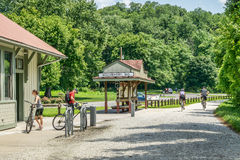 Cyclist touring Katy Trail in Missouri. ROCHEPORT, MO, USA - AUGUST 1, 2015: Cyclists at Rocheport station on Katy Trail (237 mile bike trail stretching across Stock Image
