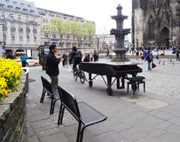 Cyclist tows piano, Cologne royalty free stock photography