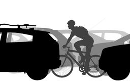 Cyclist in traffic Royalty Free Stock Photo