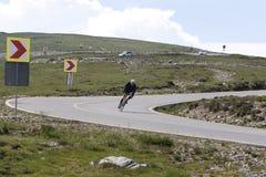 Cyclist on transalpina road Royalty Free Stock Photos