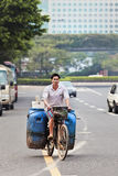 Cyclist transports waste cans on an old bike, Guangzhou, China Stock Image