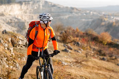 Cyclist-traveler with a backpack on mountainbike Royalty Free Stock Images