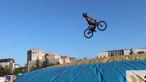 Cyclist tumbles in air during Big Air Bag jumps championship of Perm region stock video