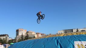 Cyclist turns in air during Big Air Bag jumps championship of Perm. PERM, RUSSIA - AUG 20, 2016: Cyclist turns in air during Big Air Bag jumps championship of stock video footage