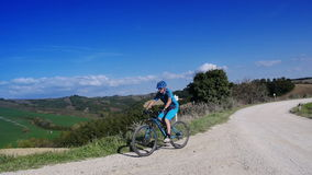 Cyclist in Tuscan landscape. Mountain biker cycling through Tuscan landscape stock video