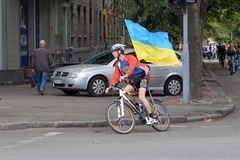 Cyclist with a Ukrainian flag stock image