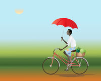 Cyclist with an umbrella Stock Photography