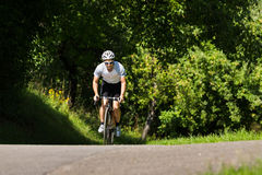 Cyclist in an uphill Stock Images