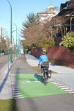 Cyclist Uses Vancouver`s Bicycle Lane Royalty Free Stock Photo