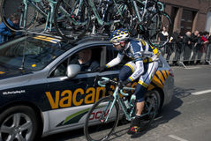 Cyclist at the team car Stock Photography