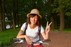 Cyclist with victory sign Stock Photo