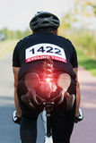 Cyclist with visible bones. Cyclist riding a bike with digital composed hip bones and spine Stock Photography