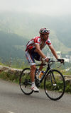 The cyclist Vladimir Gusev. Beost,France,July 15th 2011: Image of the cyclist Vladimir Gusev (Katusha team),climbing the last kilometers of the category H Royalty Free Stock Photo