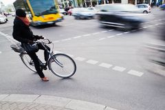 Cyclist waiting at the crossroads Royalty Free Stock Image