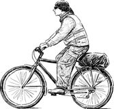 Cyclist on a walk Royalty Free Stock Images