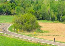 On the road while cycling. A cyclist walking on a beautiful Sunday in the countryside Royalty Free Stock Images