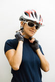 Cyclist woman. Wearing a security helmet stock image