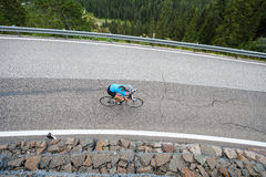Cyclist woman from above by downhill. From above - bike girl from bird`s eye view Royalty Free Stock Photo