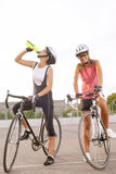 Cyclist woman takes a water break Stock Image