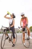 Cyclist woman takes a water break Stock Image