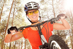 Cyclist in the woods Stock Photos