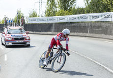 The Cyclist Yury Trofimov - Tour de France 2014. Coursac, France - July 26, 2014: The Russian cyclist Yury Trofimov ( Katusha Team) pedaling  during the stage 20 Royalty Free Stock Image