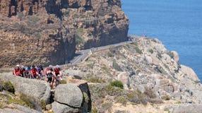 Cyclistes faisant un cycle dans un peleton sur la commande de crête de Chapmans, Cape Town, Afrique du Sud Ils se pr?parent ? la  photo libre de droits