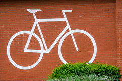 For Cyclists. Bike sign on a brick wall Stock Photos