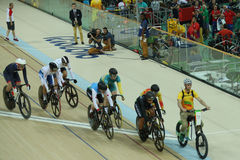 Cyclists in action during Rio 2016 Olympics women`s keirin first round heat 3 at the Rio Olympic Velodrome. RIO DE JANEIRO, BRAZIL - AUGUST 13, 2016: Cyclists in Stock Photos