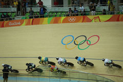 Cyclists in action during Rio 2016 Olympics women`s keirin first round heat 3 at the Rio Olympic Velodrome. RIO DE JANEIRO, BRAZIL - AUGUST 13, 2016: Cyclists in Royalty Free Stock Photo