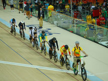 Cyclists in action during Rio 2016 Olympics women`s keirin first round heat 3 at the Rio Olympic Velodrome. RIO DE JANEIRO, BRAZIL - AUGUST 13, 2016: Cyclists in Royalty Free Stock Photos
