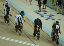 Cyclists in action during Rio 2016 Olympics women`s keirin first round heat 3 at the Rio Olympic Velodrome. RIO DE JANEIRO, BRAZIL - AUGUST 13, 2016: Cyclists in Stock Image