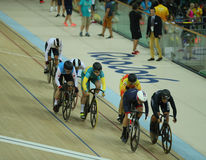 Cyclists in action during Rio 2016 Olympics women`s keirin first round heat 3 at the Rio Olympic Velodrome. RIO DE JANEIRO, BRAZIL - AUGUST 13, 2016: Cyclists in Stock Photography