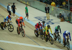 Cyclists in action during Rio 2016 Olympics women`s keirin first round heat 4 at the Rio Olympic Velodrome. RIO DE JANEIRO, BRAZIL - AUGUST 13, 2016: Cyclists in Royalty Free Stock Photo